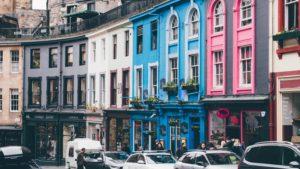 cars parked near multi-color buildings