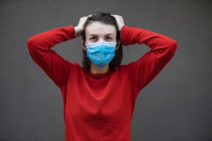 man in red sweater with face mask