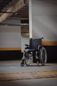 black and gray wheelchair on blue floor